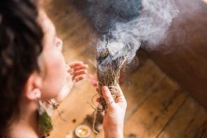 woman lighting incense